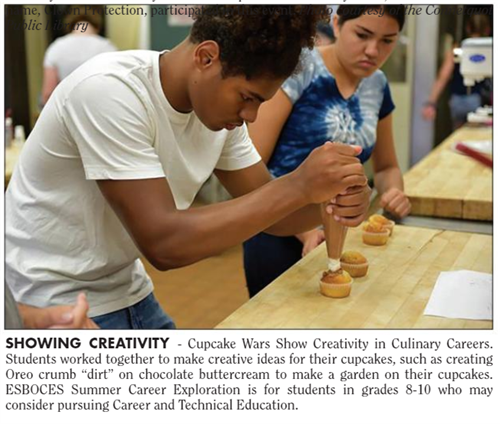 "A clip from a news article that is titled ""Showing Creativity "" and shows a student piping frosting on a cupcake"
